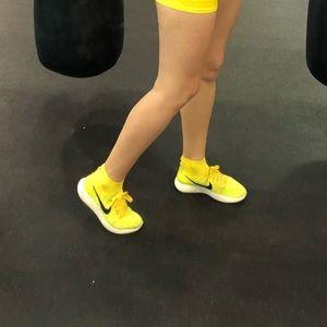 Neon yellow nike sock shoes